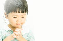 a girl child praying