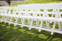 row of white folding chairs