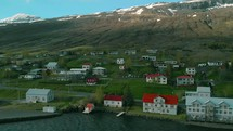 homes along a shore and view of snow capped mountains