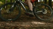 man riding a bike on a dirt trail