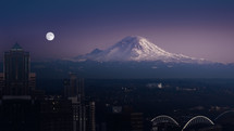 Mt Rainier and Seattle at night