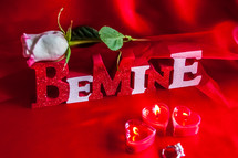 Be Mine, long stem rose, and heart shaped votive candles
