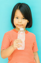 girl holding a water bottle