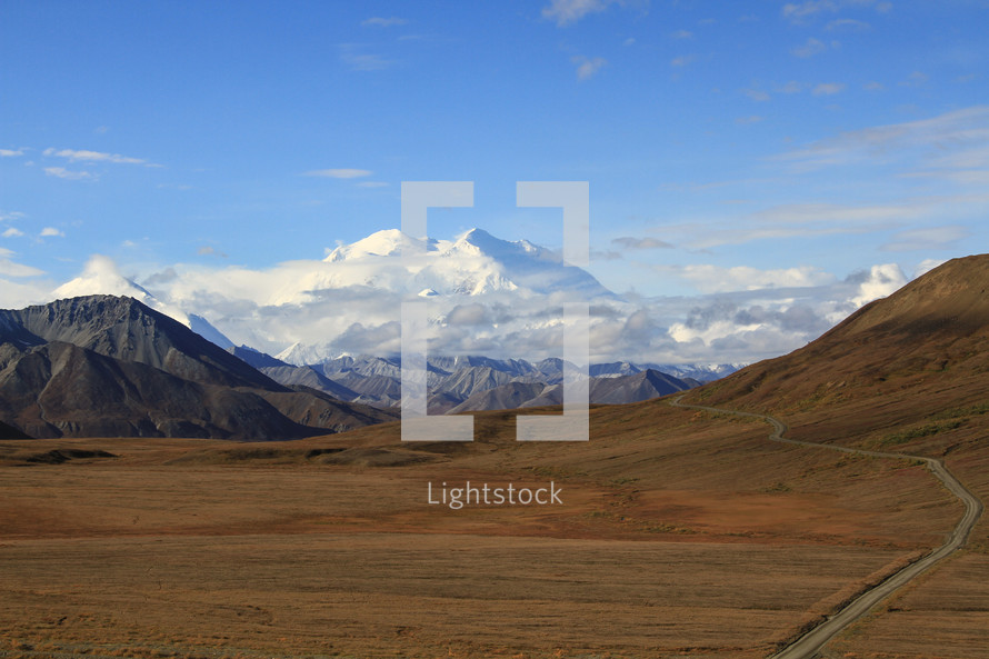 snow capped mountain and plains