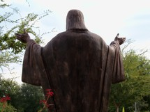 A statue of Jesus with His hands outstretched to teach, minister and encourage all who see Him.