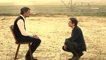 two men talking outdoors
