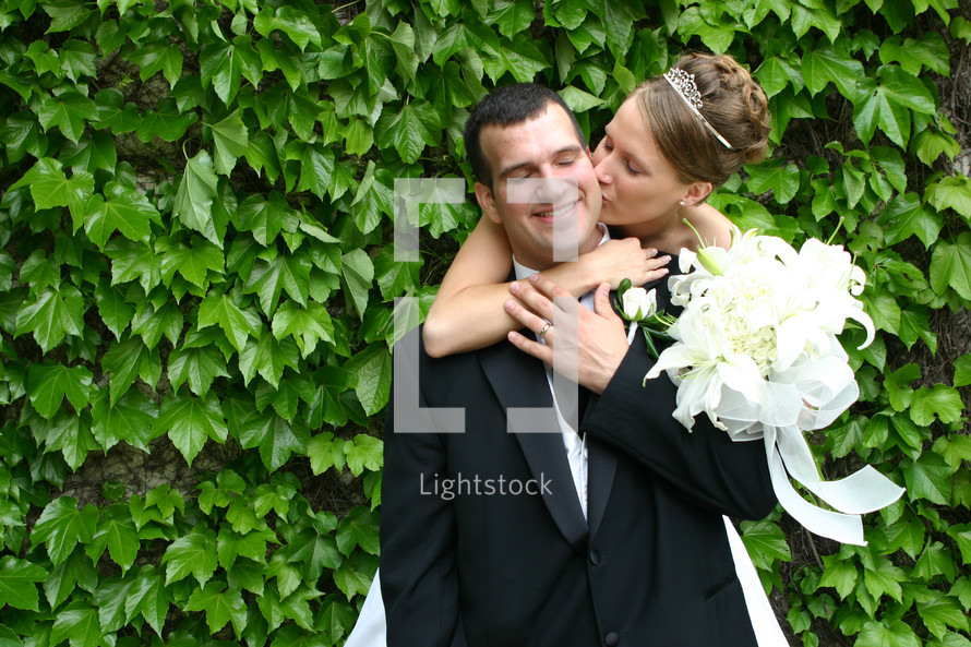 bride kissing broom