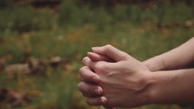woman's praying hands