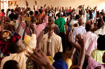raised hands in an African church