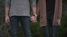 couple standing together holding hands