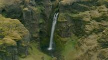 waterfall off a green mountainside
