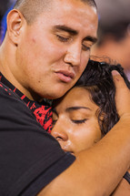 Couple hugging tears of joy for salvation
