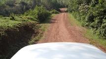 van traveling on a dirt road