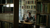 college student studying in a library