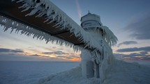 Timelapse of sunset of an ice-covered lighthouse on Lake Michigan during the polar vortex winter weather event.