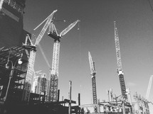 construction cranes in a city