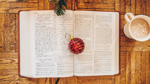 Christmas ornament on the pages of an open Bible