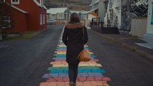 a woman walking on a colorful path
