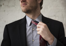 businessman taking off his tie