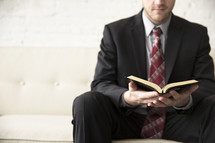 businessman reading a Bible