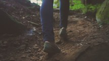 woman walking up a mountain trail