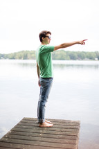 man on a dock pointing