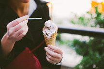 a woman eating a waffle cone