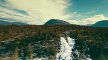 aerial view over a waterfall in Norway