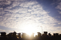 sunlight shining on the heads of graduates