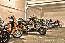 parked group of motorcycles lined up