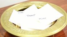 offerings in an offering plate