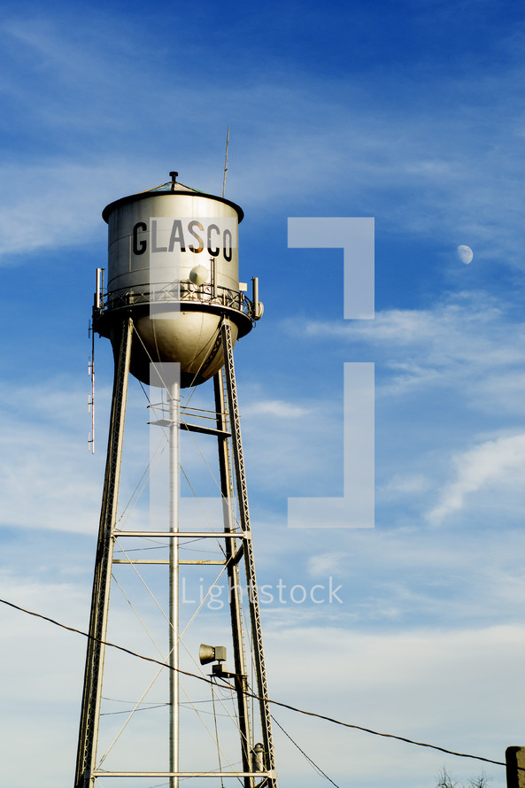 Glasco water tower in daylight against blue sky.