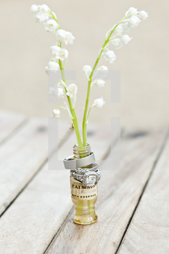 Wedding rings on a small vase