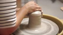 potter at a potter's wheel