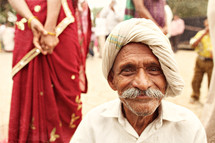man with a mustache in India smiling