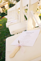 Wedding program on chair