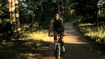 man riding a bicycle on a trail