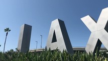 The famous LAX airport sign at Los Angeles International Airport slow pan.