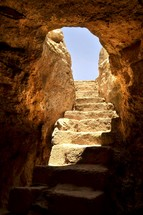 steps out of a tomb