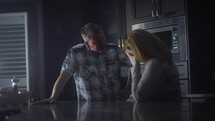 couple fighting in the kitchen