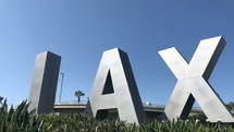 The famous LAX airport sign at Los Angeles International Airport.