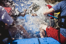 water splashing while whitewater rafting