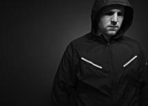 A man wearing a hood