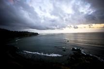 tide on a rocky beach in dim light