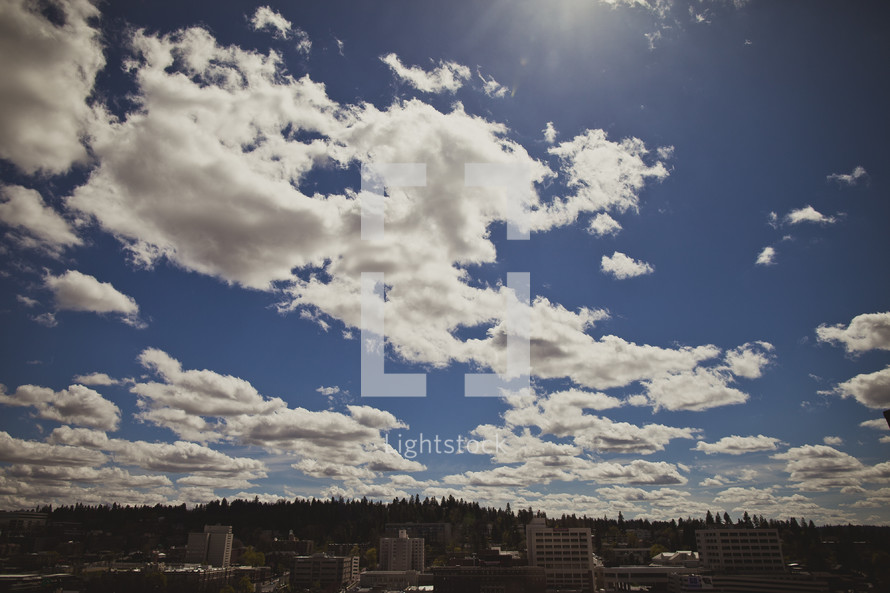 Beautiful clouds in a blue sky over a town