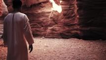 man walking through the desert