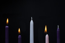 advent candles on a black background