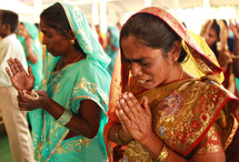 women in prayer in India