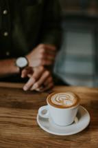 wheat design in a creamer in coffee