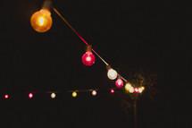 String of lights across trees